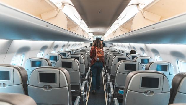 Woman exiting an airplane
