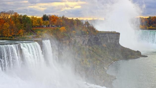 Beautiful fall colors on the cliff of American Falls of Niagara Falls on the New York side