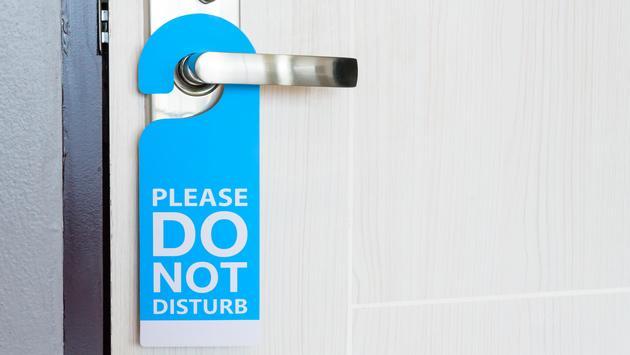 Do Not Disturb sign on a hotel room door