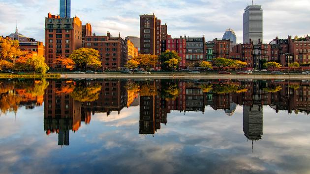 Reflection of Back Bay in Boston along the Charles River (photo courtesy of JC Ruiz / iStock / Getty Images Plus)