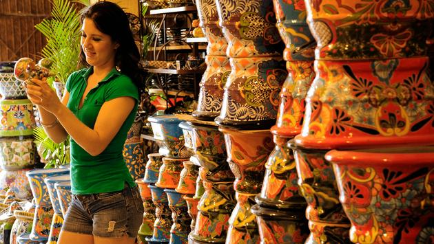 A woman browses locally made painted pottery in Guanajuato