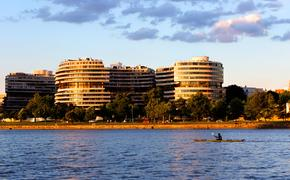 The Watergate Hotel in Washington, DC with the Potomac River in the foreground