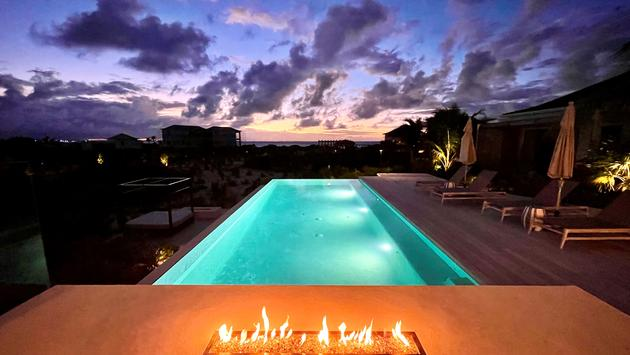 Evening fire on the patio at Beach Enclave Grace Bay