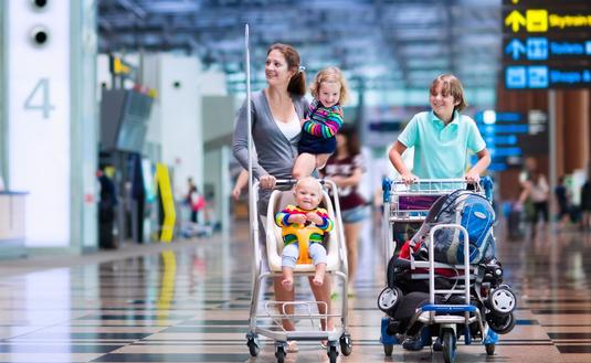 Happy family with kids at airport