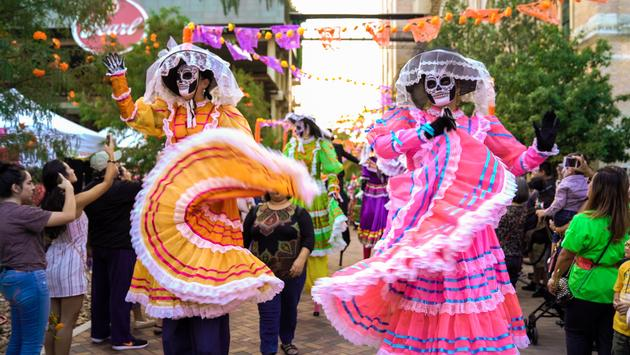 A colorful Dia de Muertos parade in San Antonio's historic Pearl brewery district.