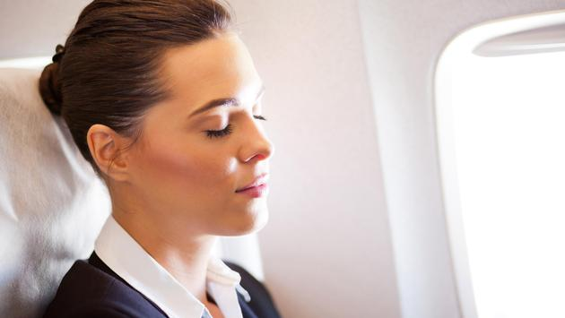 Businesswoman resting on a plane