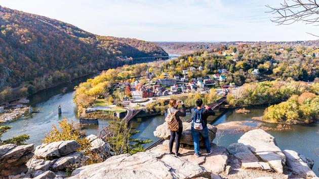 Hikers take photos overlooking Harpers Ferry, West Virginia