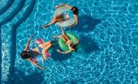 Aerial top view of family in swimming pool