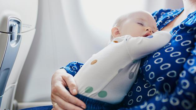 Child napping on plane, airplane, baby