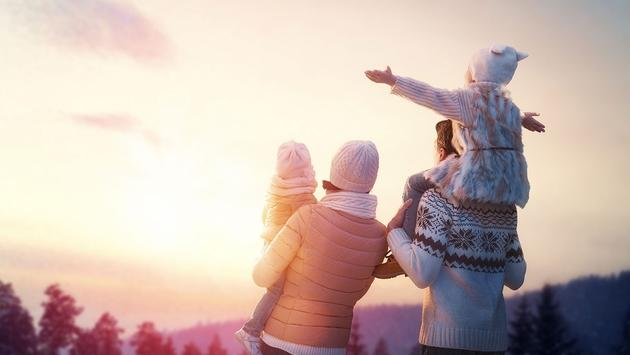 Happy family at sunset in winter (Photo via Choreograph / iStock / Getty Images Plus)