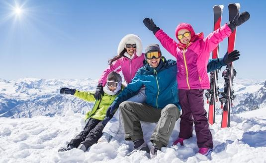 Happy family in winter holiday (Photo via Ridofranz / iStock / Getty Images Plus)