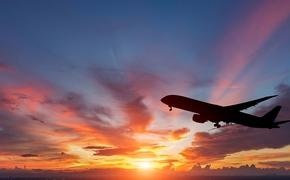 The silhouette of a passenger plane flying in sunset. (Photo via manop1984 / iStock / Getty Images Plus)