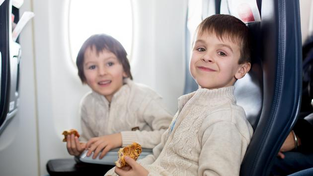 Kids eating on a plane, child, food, airplane