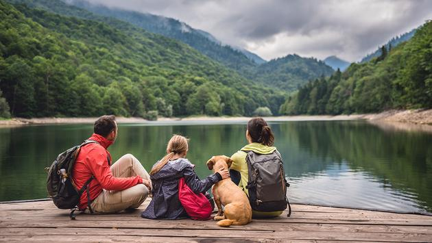 Family with dog resting on a pier (Photo iva  Kerkez / iStock / Getty Images Plus)