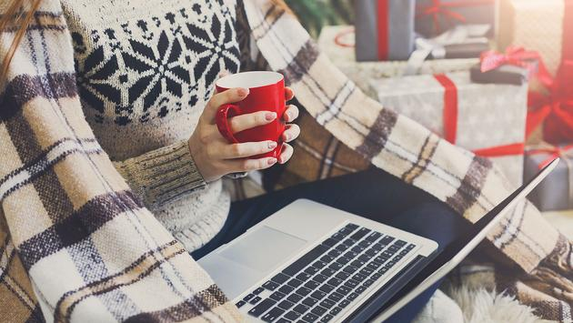 Woman shopping online preparing to christmas (Photo via Milkos / iStock / Getty Images Plus)