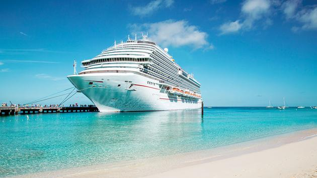 Cruise ship moored at Grand Turk island, the Caribbeans (Photo via mikolajn / iStock Editorial / Getty Images Plus)