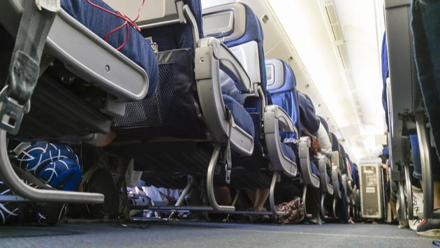 The aisle of passenger airplane