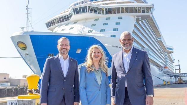 Holland America Line President Princess Cruises President Jan Swartz, and Carnival Corporation & plc President & CEO Arnold Donald in front of Majestic Princess in the Port of Seattle.