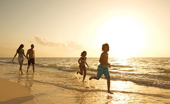 A family on the beach, now resorts