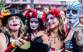 A group of women celebrating Day of the Dead during a parade in Fort Lauderdale, Florida