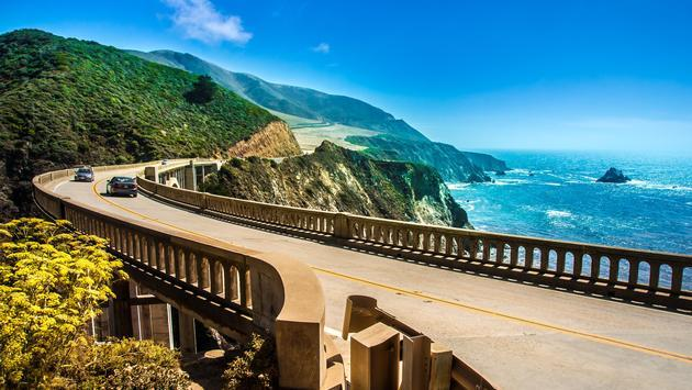 Cars driving on the Bixby Creek Bridge on California's Big Sur coast