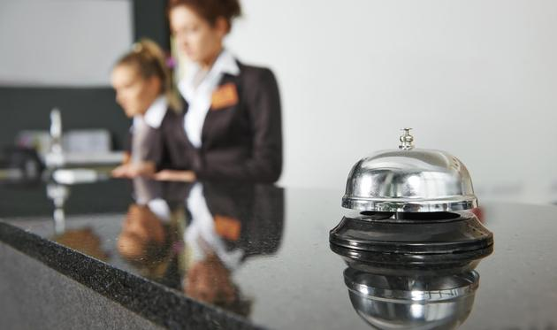 Hotel reception with a bell
