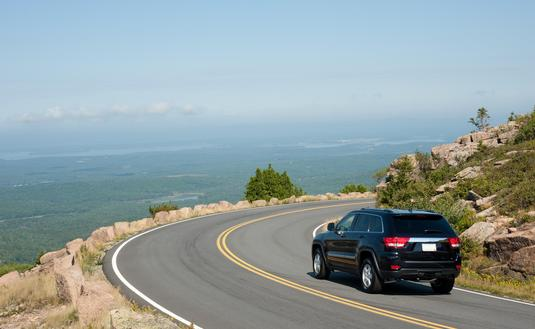 An SUV driving Cadillac Mountain in Maine's Acadia National Park