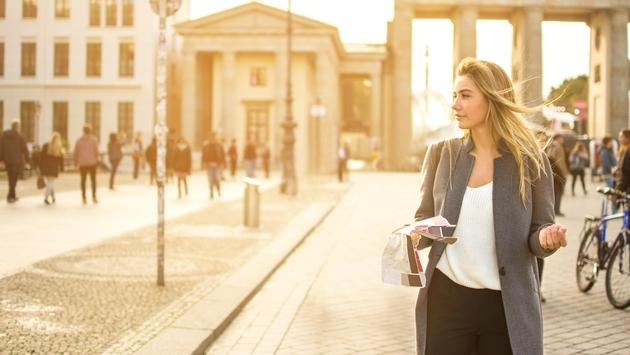 Young woman holding a city map in Berlin, Germany