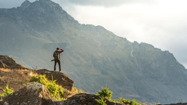 Man taking in the mountain scenery in Queenstown, New Zealand
