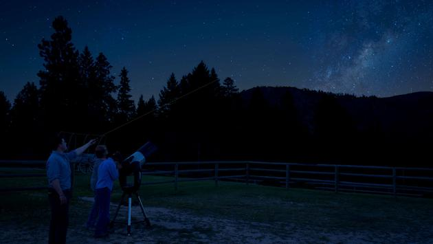 Guests stargazing at Triple Creek Ranch