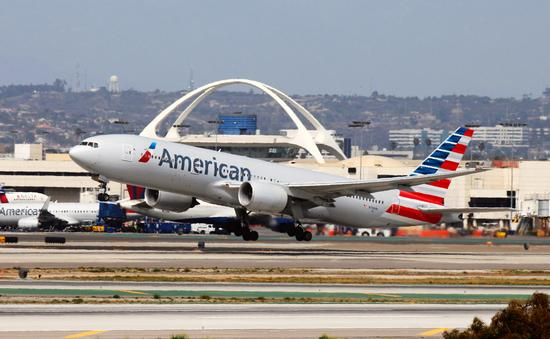 An American Airlines Boeing 777 taking off from Los Angeles International Airport