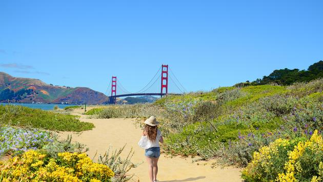 Woman hiking solo near the Golden Gate Bridge in San Francisco