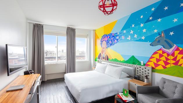 Frida Kahlo mural above guestroom bed at NU Hotel Brooklyn