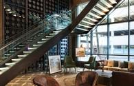 Porter Portland lobby library with art, leather furniture, staircase