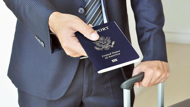 Businessman giving U.S. passport