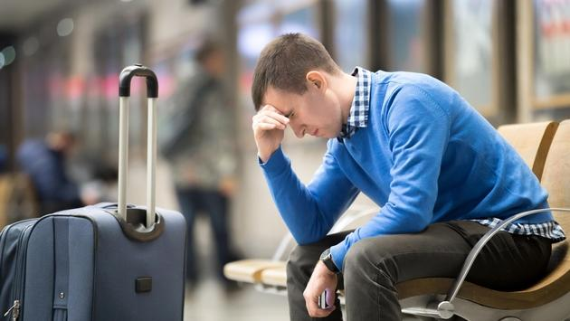 Young frustrated man at airport
