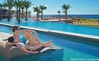 Greetings From Paradise! Save up to $2,138 Per Couple at AMResorts!
