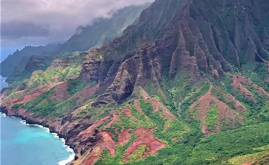 Red Green mountains and blue turquoise ocean