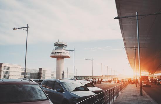 Parking lot of modern airport terminal