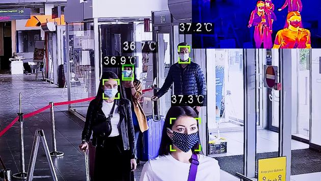Temperature-scanning technology and thermal imaging at an airport terminal.