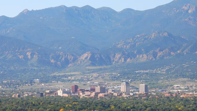 Downtown Colorado Springs set against the Rocky Mountains.