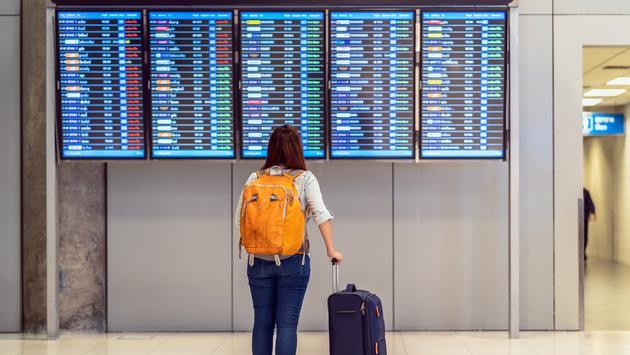 Passenger checking the flight schedule