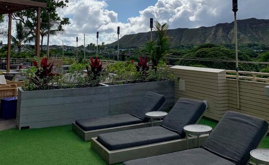 Sunbathe with a scenic view at the Queen Kapiolani in Hawaii