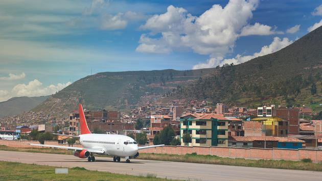 Plane waiting to take off at Cusco airport in Peru