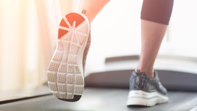 Close-up of a woman running on the treadmill