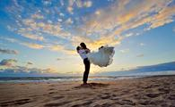 Bride and groom destination wedding on the beach