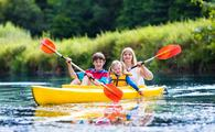 A family enjoys a kayak ride.