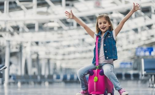A young girl enjoys her time at the airport.