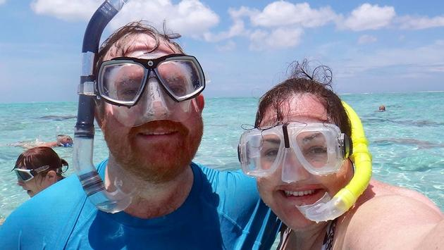 Author Jason Leppert, sporting his newfound prescription snorkel goggles, and his wife, Heidi, pose for a selfie