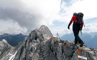 A hiker walks along the Arlberger Klettersteig, Austria